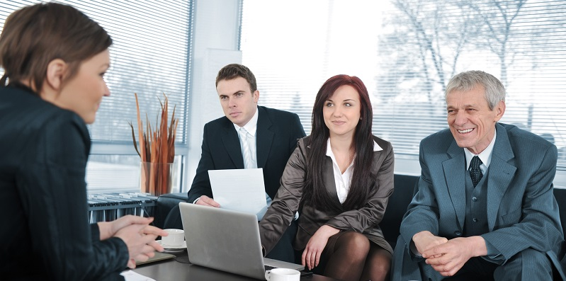 Businesswoman in an interview with three business people getting positive feedback
