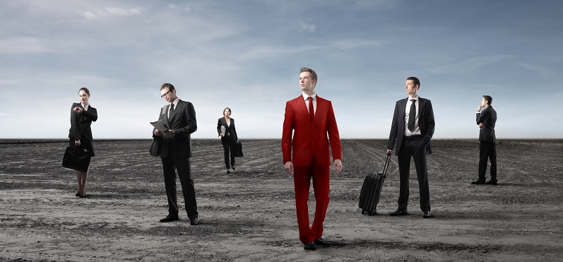 Business people in black and young businessman in red
