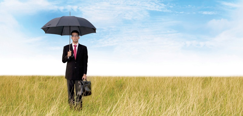 Businessman with umbrella shot outdoor