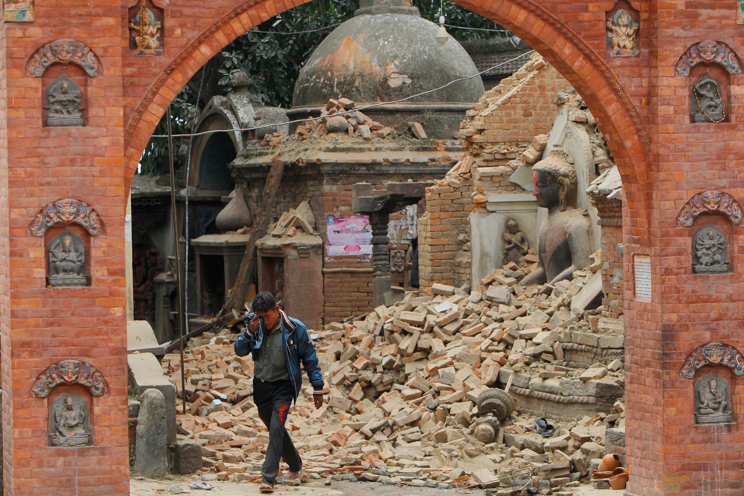 A Nepalese man cries as he walks through the earthquake debris inBhaktapur, near Kathmandu, Nepal, Sunday, April 26, 2015. A strong magnitude 7.8 earthquake shook Nepal's capital and the densely populated Kathmandu Valley before noon Saturday, causing extensive damage with toppled walls and collapsed buildings, officials said. (AP Photo/Niranjan Shrestha)