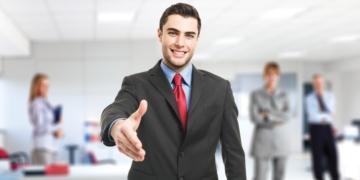 Portrait of an handsome businessman giving an handshake
