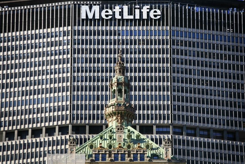 "FILE - In this April 16, 2009, file photo, the MetLife skyscraper overlooks another building in New York. MetLife has won a major legal challenge to the government's policy for preventing another financial crisis, as a federal judge on Wednesday, March 30, 2016, tossed out its designation by regulators as a potential threat to the financial system. MetLife Inc., the largest U.S. insurance company by assets, took the government to court more than a year ago to appeal its labeling by the Financial Stability Oversight Council as ""systemically important."" (AP Photo/Mark Lennihan, File)"