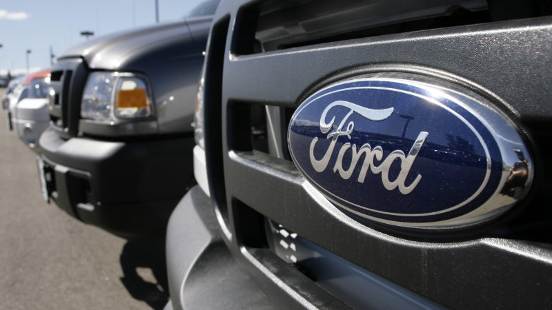 The Ford emblem shines off the grille of an unsold 2007 Ranger pickup truck parked on the lot of a Ford dealership in Broomfield, Colo., on Sunday, Sept. 24, 2006. Demand for cars, airplanes and other transportation products was up 3.7 percent, as strength in autos offset further weakness in commercial aircraft. (AP Photo/David Zalubowski)