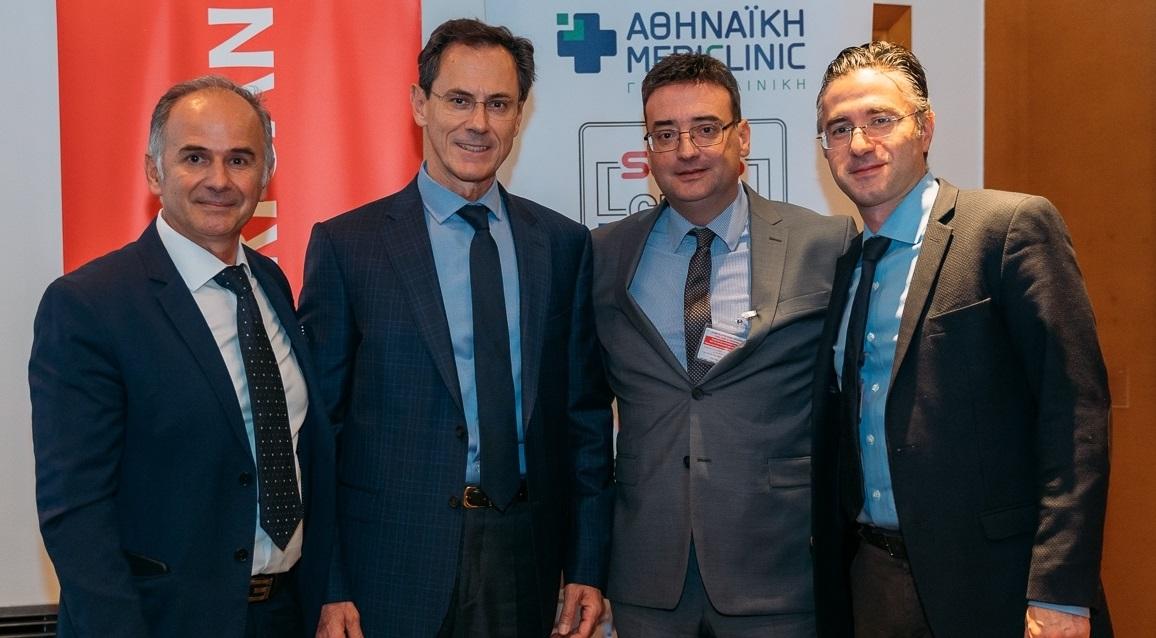 Οι τρείς ιατροί ομιλητές Δρ Χ. Ηλίας, Δρ Ν. Κουτσογούλας και Δρ Μ. Καραβιτάκης με τον Α. Γερονικολάου, γενικό διευθυντή της Αθηναϊκής Mediclinic
