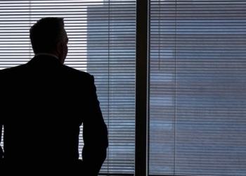 businessman looking the window