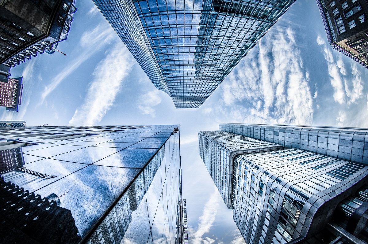 low-angle-photo-of-four-high-rise-curtain-wall-buildings