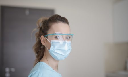 woman-in-blue-shirt-wearing-face-mask,covid-19