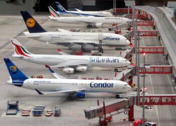 condor-airplane-on-grey-concrete-airport-insurancedaily