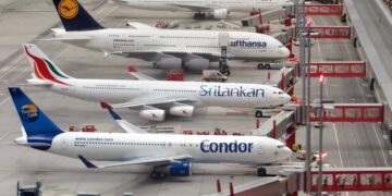 condor-airplane-on-grey-concrete-airport-insurancedaily