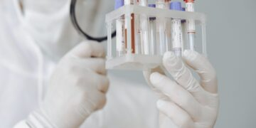 person-holding-test-tube-rack