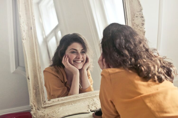 photo-of-woman-looking-at-the-mirror-insurancedaily