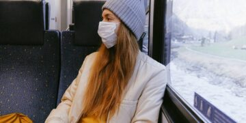 woman-in-gray-knit-cap-and-beige-coat-insurancedaily