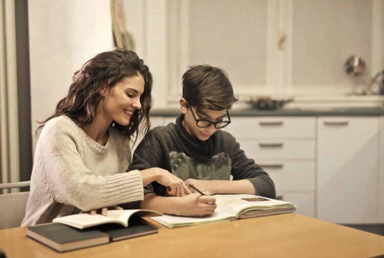 elder-sister-and-brother-studying-at-home-insurancedaily