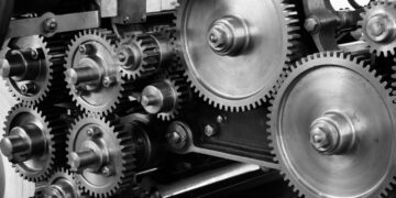 gray-scale-photo-of-gears-insurancedaily