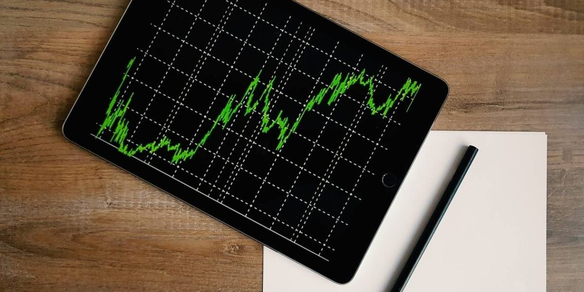 space-grey-ipad-air-with-graph-on-brown-wooden-table-insurancedaily
